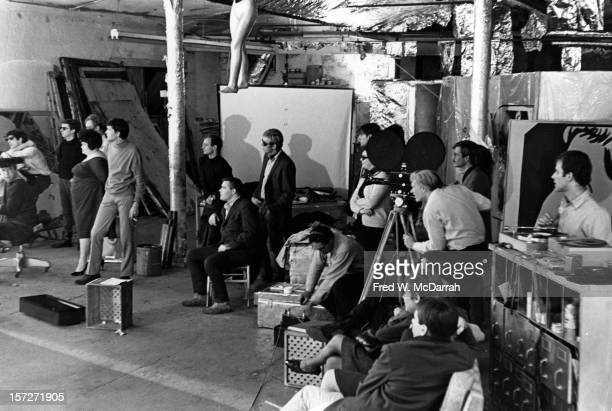 View of the cast and crew during the filming of the movie 'Camp' directed by pop artist Andy Warhol at his studio the Factory New York New York...