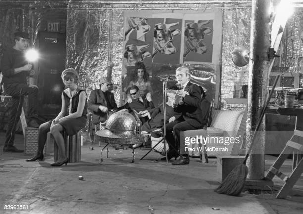 View of the cast and crew during the filming of the movie 'Camp' directed by Andy Warhol at Warhol's studio the Factory New York New York October 30...