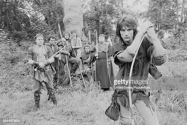 View of the cast of the television adventure series 'Robin of Sherwood' pictured together dressed in character in woodland in England on 24th June...