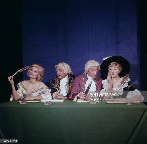 View of the cast of the theatre revue 'The Lord Chamberlain Regrets' featuring English actress Joan Sims on right pictured together in period costume...