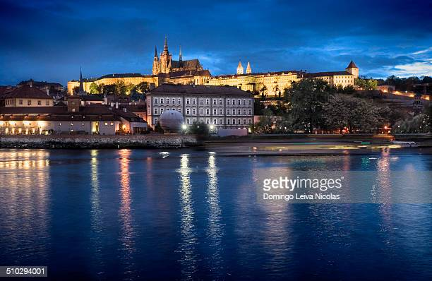 View of the castle from the river side in Prague at dusk.