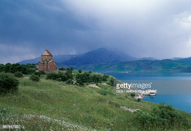 View of the Cathedral of the Holy Cross on the Lake Van before the restoration Akdamar Island Eastern Anatolia Turkey Armenian civilization 10th...
