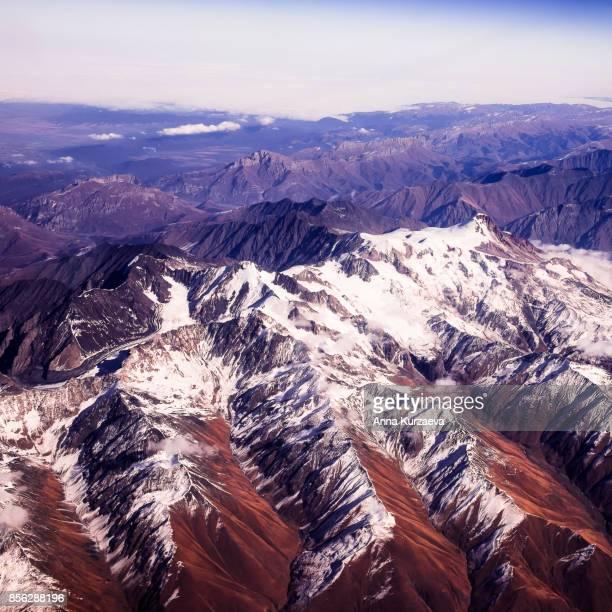 view of the caucasus mountain range with mountain peaks, top view - コーカサス山脈 ストックフォトと画像