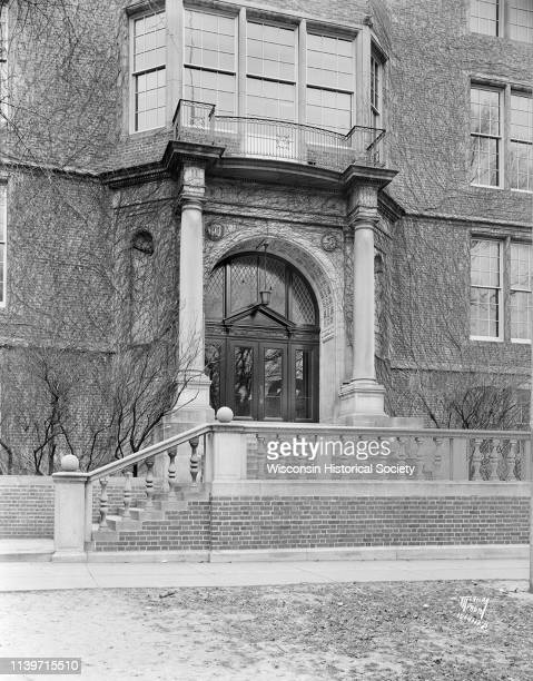 View of the Central High School entrance arch at 214 Wisconsin Avenue Madison Wisconsin December 9 1933 Ivy is growing around the entrance and is...