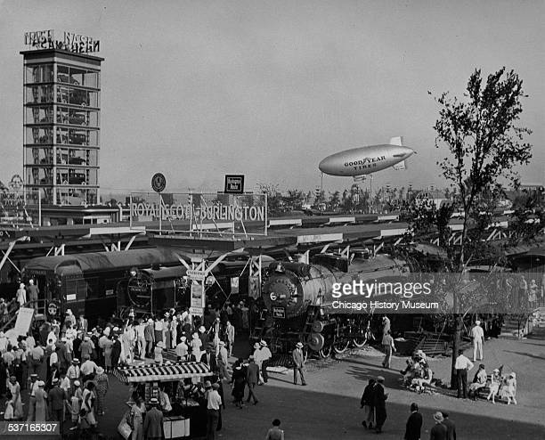 View of the Century of Progress world's fair including the Burlington and Royal Scot trains Goodyear Blimp and Nash Autos Chicago Illinois 1933