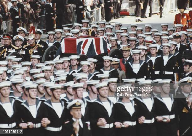 View of the ceremonial funeral of Lord Louis Mountbatten with the union flag draped coffin being transported on a gun carriage with a naval escort...