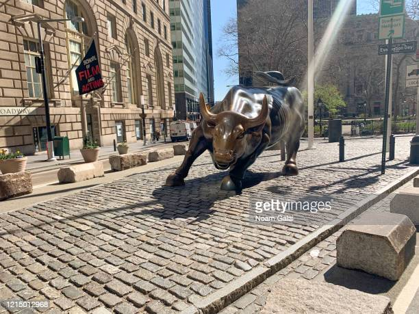 View of the 'Charging Bull' sculpture in the Financial District in New York City as the coronavirus continues to spread across the United States on...