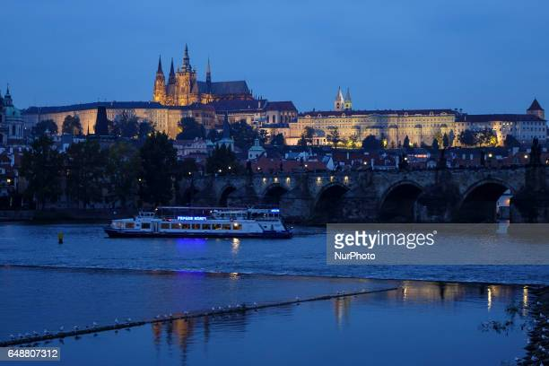 View of the Charles Bridge by night an historic bridge that crosses the Vltava river in Prague Czech Republic