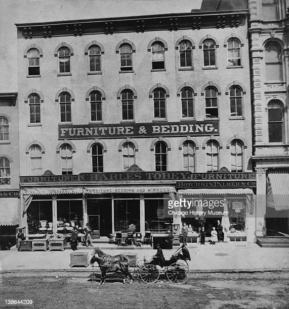 View of the Charles Tobey Furniture and Bedding store at 878991 State Street Chicago Illinois late 1860s