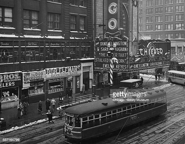 View of the Chicago Theatre from State and Lake L station looking southeast along State Street in Chicago Illinois January 1951