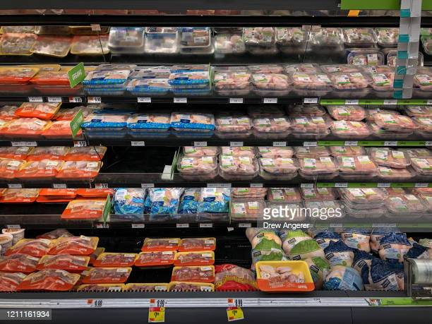 View of the chicken and meat section at a grocery store, April 28, 2020 Washington, DC. Meat industry experts say that beef, chicken and pork could...