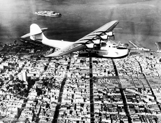 View of the China Clipper as she leaves San Francisco to Manila at the start of her historic flight across the Pacific Ocean for the first...