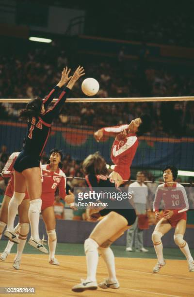 View of the China female volleyball team competing against the United States female volleyball team in the gold medal match of the Women's volleyball...