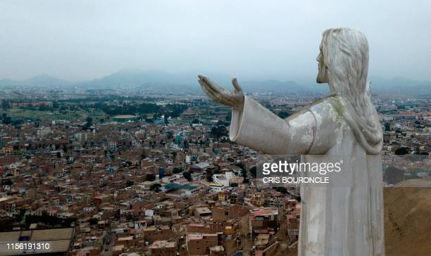 View of the Christ of the Pacific statue atop a hill in Lima on July 15 2019 The giant statute of Jesus Christ that looms large over Lima has caused...