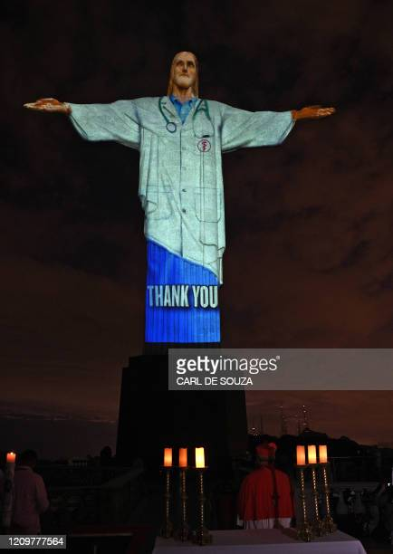 View of the Christ the Redeemer atop Corcovado hill in Rio de Janeiro Brazil on April 12 2020 The world famous landmark had a doctor's uniform...