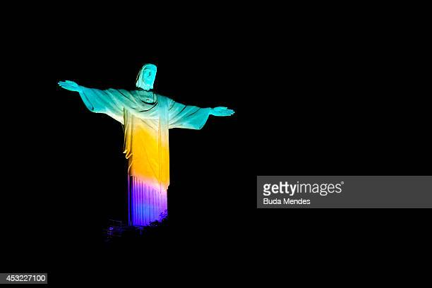 View of the Christ The Redeemer Lit Green Yellow and Blue Two Years Ahead Of Rio 2016 Olympics Opening Ceremony on August 5 2014 in Rio de Janeiro...