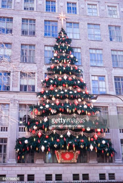 View of the Christmas tree decorations attached to the facade of the Saks Fifth Avenue building located between 49th and 50th Streets on the east...