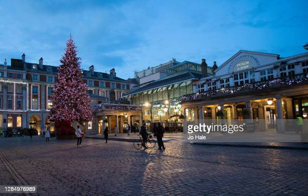 View of The Christmas Tree Lit up in Covent Garden during the second Coronavirus Lockdown on November 10, 2020 in London, England.