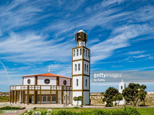 view of the church of costa nova with the beach in the background, aveiro, portugal - aveiro district stock pictures, royalty-free photos & images