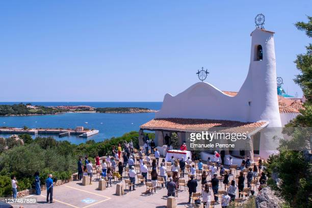 A view of the church of Porto Cervo as the parish priest Don Raimondo Satta celebrates mass in the open to respect the social distancing measures for...