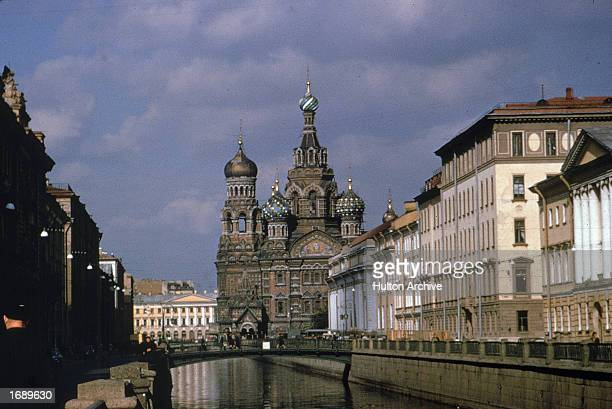 View of the Church of the Resurrection of Christ and a canal in St Petersburg Russia St Petersburg was named Leningrad under Soviet rule