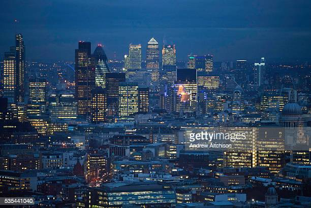 A view of the city of London at night from the top of the BT tower The square mile and Canary Wharf can be seen