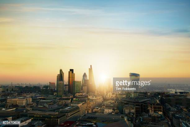 view of the city of london finance district with sun - dawn stock pictures, royalty-free photos & images