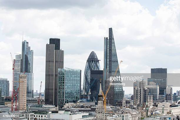 A view of the City of London financial district including 30 St Mary Axe also known as the 'Gherkin' and the Leadenhall building also known as the...