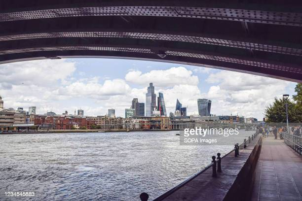 View of the City of London skyline and River Thames beneath Blackfriars Railway Bridge.