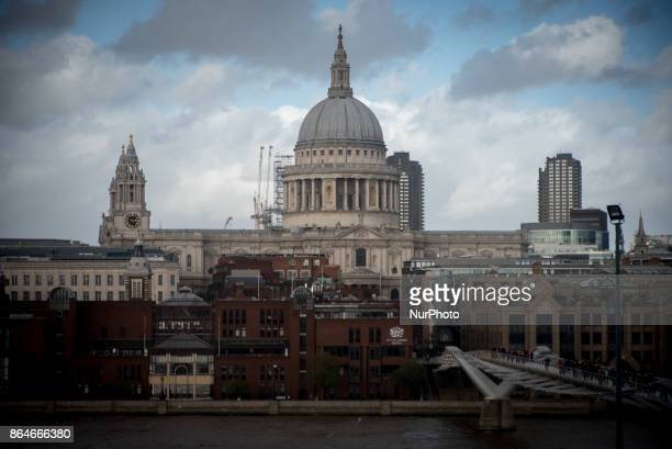 View of the City of London's skyline including the iconic St Paul's Cathedral and a rainbow that emerges from the clouds London on October 21 2017