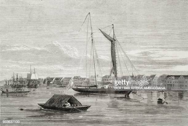 View of the city of Paramaribo from the Suriname river boats in the foreground Suriname illustration from the magazine The Illustrated London News...