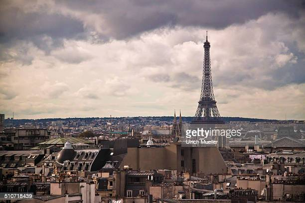 View of the cityscape of Paris with the Eiffel tower in the background.