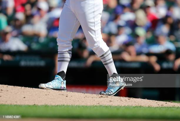 A view of the cleats worn by Derek Holland of the Chicago Cubs during the game against the Washington Nationals at Wrigley Field on August 23 2019 in...