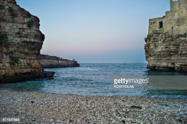 A view of the cliff and the little beach at Polignano a Mare in Puglia southern Italy