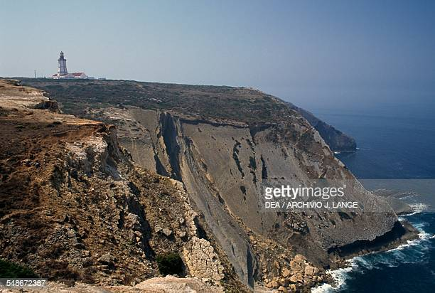 View of the cliffs overlooking the Atlantic at Cabo Espichel headland with the lighthouse in the background Province of Extremadura Portugal