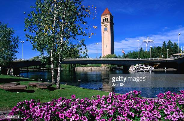 a view of the clock tower in riverfront park from across the spokane river. - spokane stock pictures, royalty-free photos & images