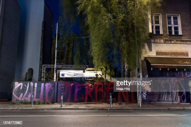 """View of the closed Kit Kat club that is turned into a corona test station and graffiti that reads """"Clubs are dying"""" during the third wave of the..."""