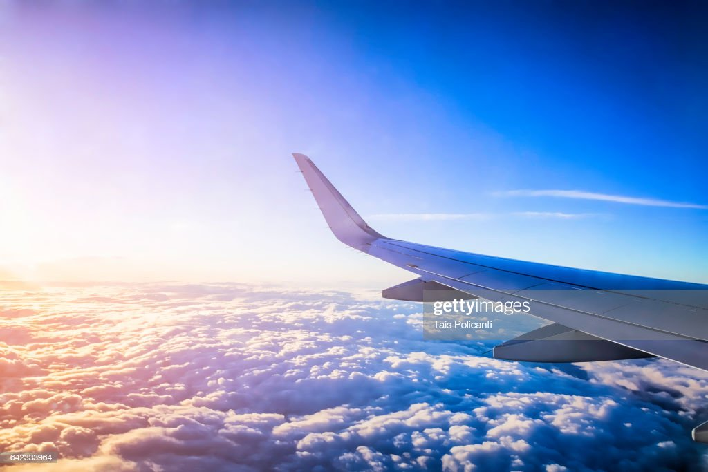 View of the clouds and sunset from an airplane window : Stock Photo