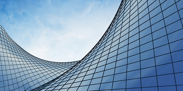 View of the clouds reflected in the curve glass office building. 3d rendering 954282570