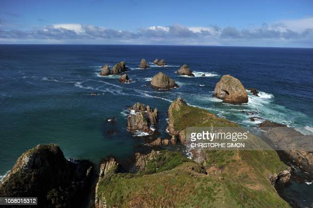View of the coast from the light house of Nugget point in The Catlins on September 25 2011 AFP PHOTO / CHRISTOPHE SIMON