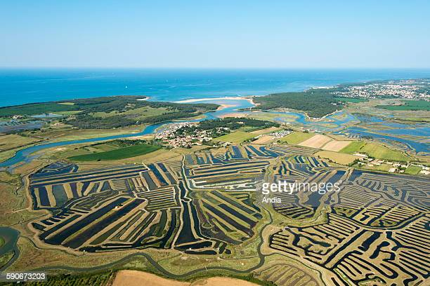 View of the coast in Talmont Saint Hilaire along the coast of the Vendee department on the 'cote de lumiere' Aerial view of the Benest salt marsh in...