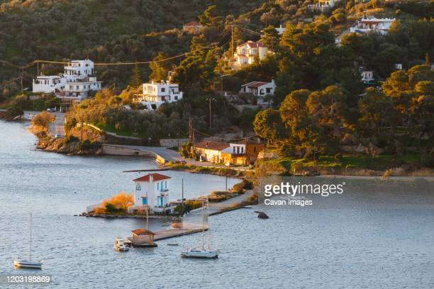view of the coast near galatas village in peloponnese peninsula. - peninsula de grecia fotografías e imágenes de stock