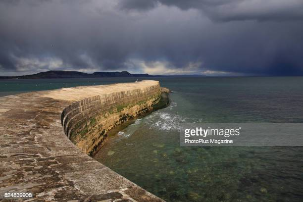View of the coastal wall known as The Cobb at Lyme Regis in Dorset, England, taken on April 26, 2016.