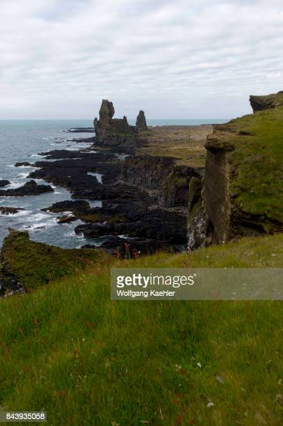 View of the coastline with a pair of rock pinnacles which are volcanic plugs of basalt at Londrangar on the Snaefellsnes Peninsula in western Iceland