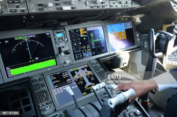 View of the cockpit of a Boeing 787-10 Dreamliner test plane presented on the Tarmac of Le Bourget on June 18, 2017 on the eve of the opening of the...