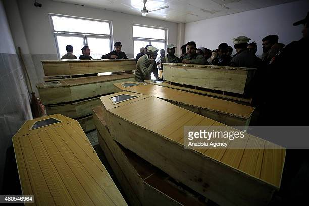 A view of the coffins at Lady Reading Hospital where the casualties of Taliban gunmen attack on a school are carried in the northwestern city of...