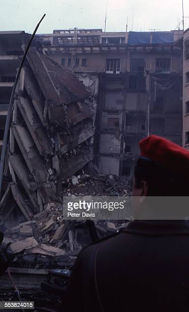 View of the collapsed facade and damage at the scene of the suicide bombing of the American Embassy, Beirut, Lebanon, April 18, 1983.