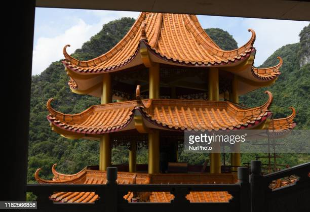 A view of the colorful decorated roofs and buildings in Putuo Temple On Friday October 20 in Nongla Scenic Area Mashan County Guangxi Region China