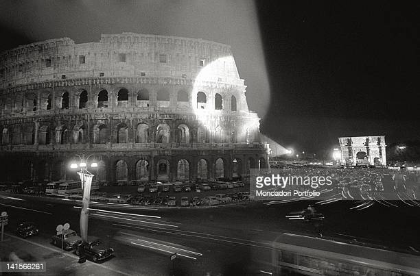 View of the Colosseum and the Arch of Constantine being lighted during the Rome Olympic Games Rome 1960