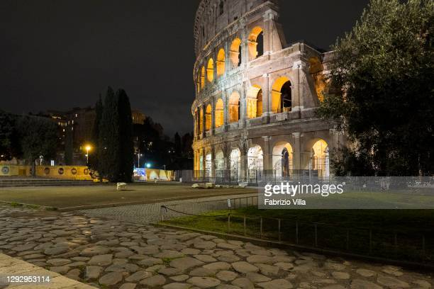 View of the Colosseum in the evening without people on Christmas Eve on the first day of lockdown on December 24, 2020 in Rome, Italy. Italy will...